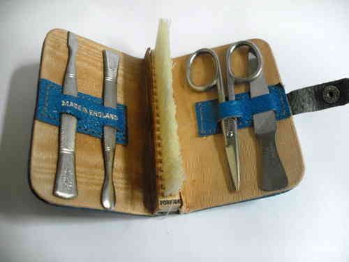 Small blue leather manicure set