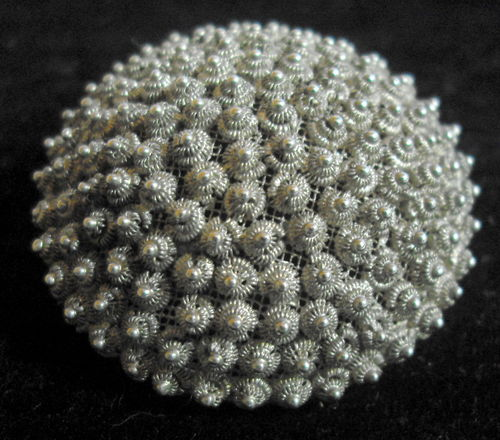 Mesh backed white metal brooch