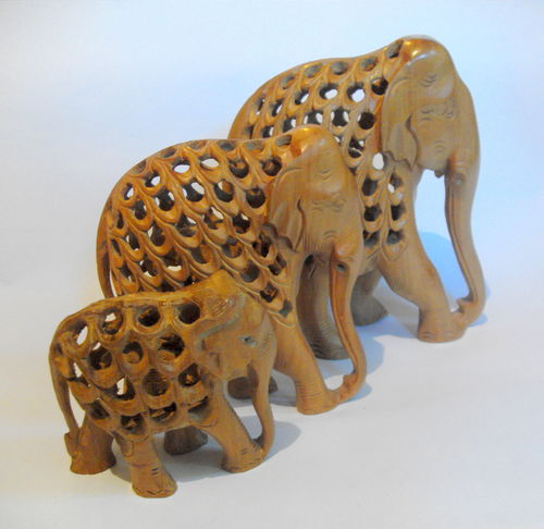 Trio of wooden elephants
