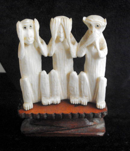 Three wise monkeys figure