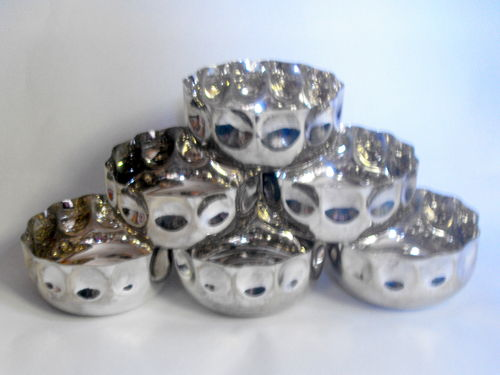 Six plated metal bowls