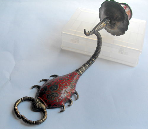 Scorpion shaped wall sconce