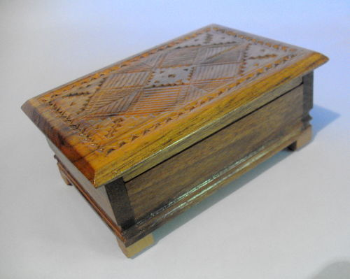 Carved box with hinged lid