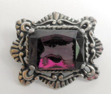 Amethyst glass brooch