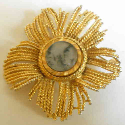 Gold tone sun brooch