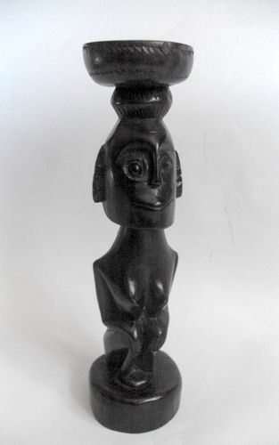 Carved sitting figure