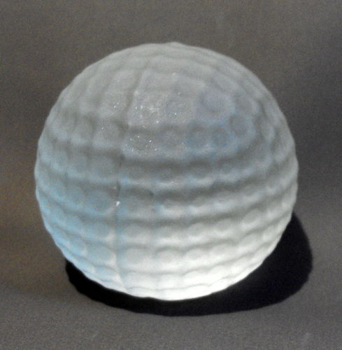 Golf ball shaped paperweight