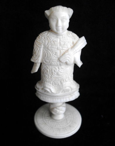 Small carved Asian figure