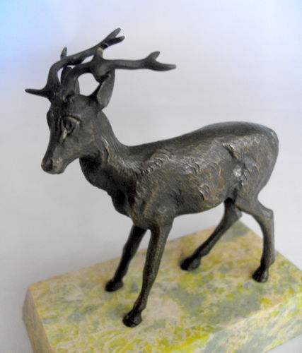 Bronze deer on marble plinth